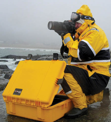 peli-storm-case-im2700-with-photographer-on-coast.jpg